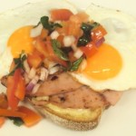 Cheese toast, fried egg and tomato onion, basil salsa